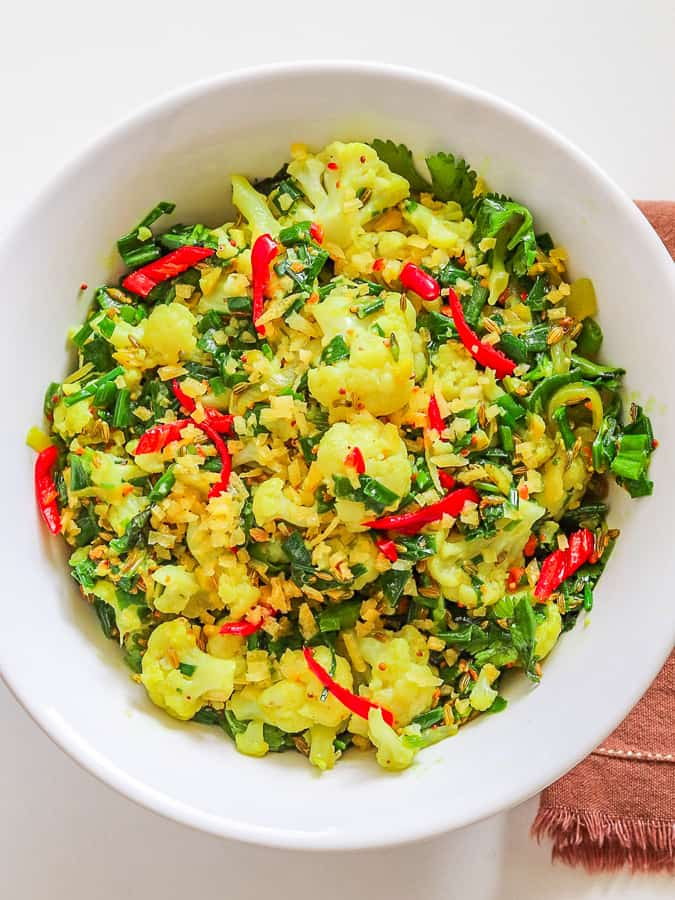 Steamed cauliflower seasoned with herbs & spices in a serving bowl