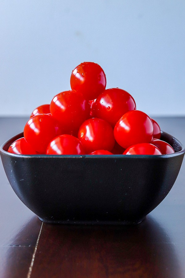 cherry tomatoes in a black bowl