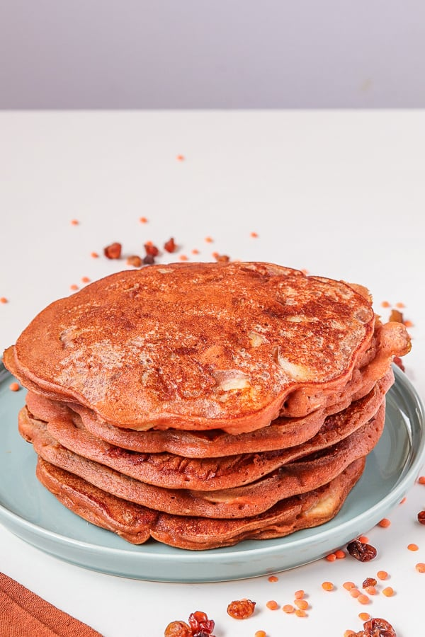 fluffy vegan pancakes with red lentils in a blue plate