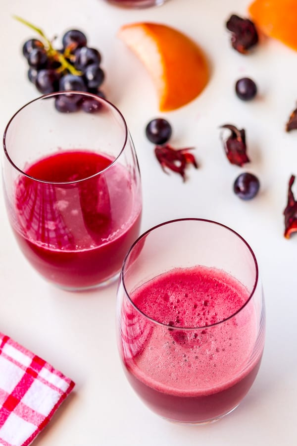 2 glasses of fresh grapefruit juice with grapes & hibiscus