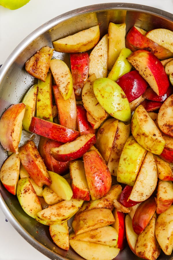 Cooking spiced apples in a pan