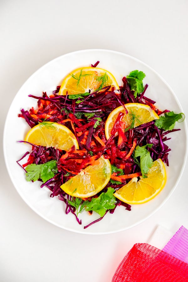 Red cabbage recipe with beets & oranges in a white plate