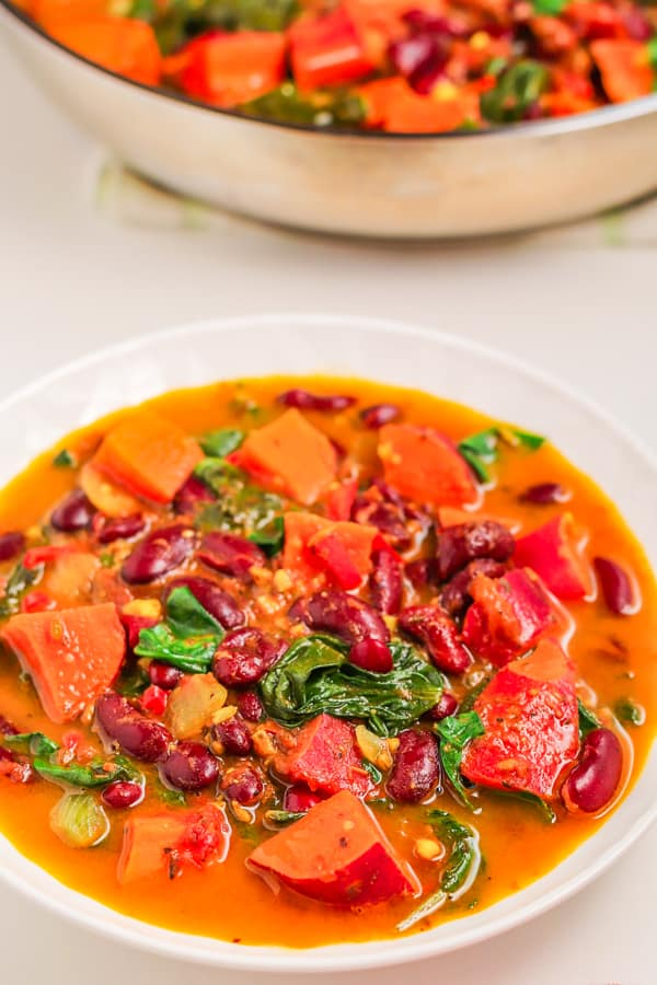 served spicy healthy sweet potato stew