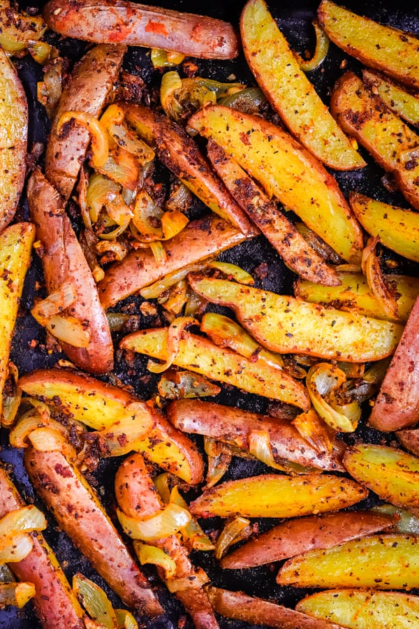 Oven-baked potato wedges in a baking sheet