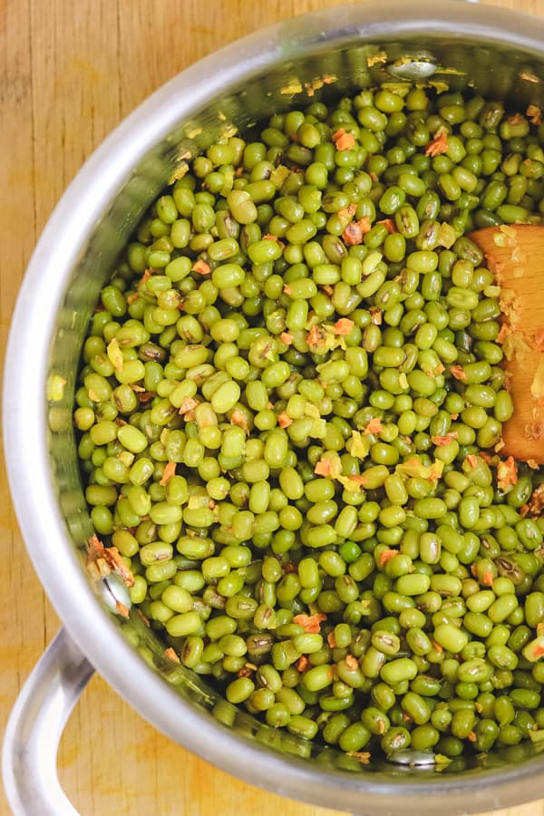 cooking mung beans in a pan