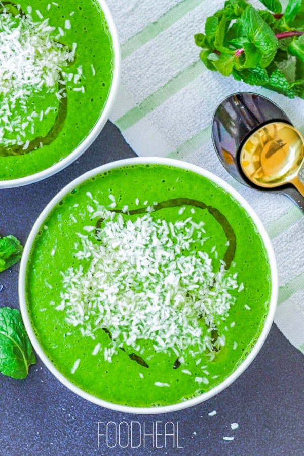 served watercress soup with green peas in white bowls