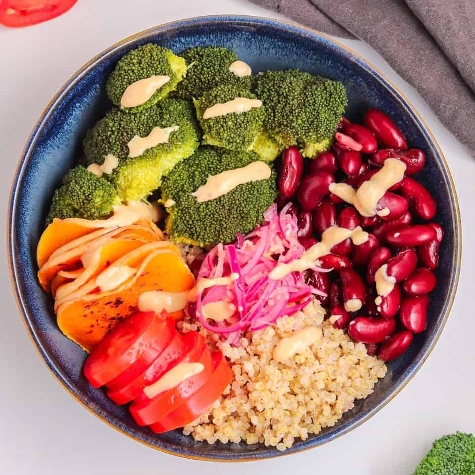 vegan buddha quinoa bowl with yogurt dressing