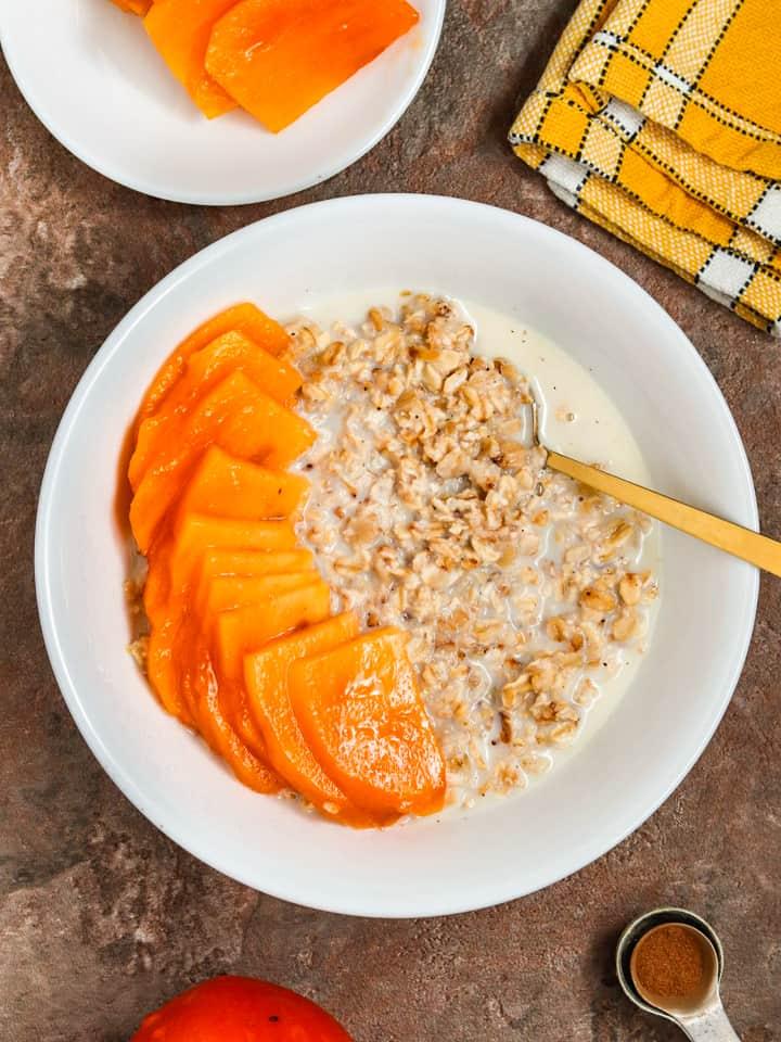 Vegan oats breakfast with persimmon