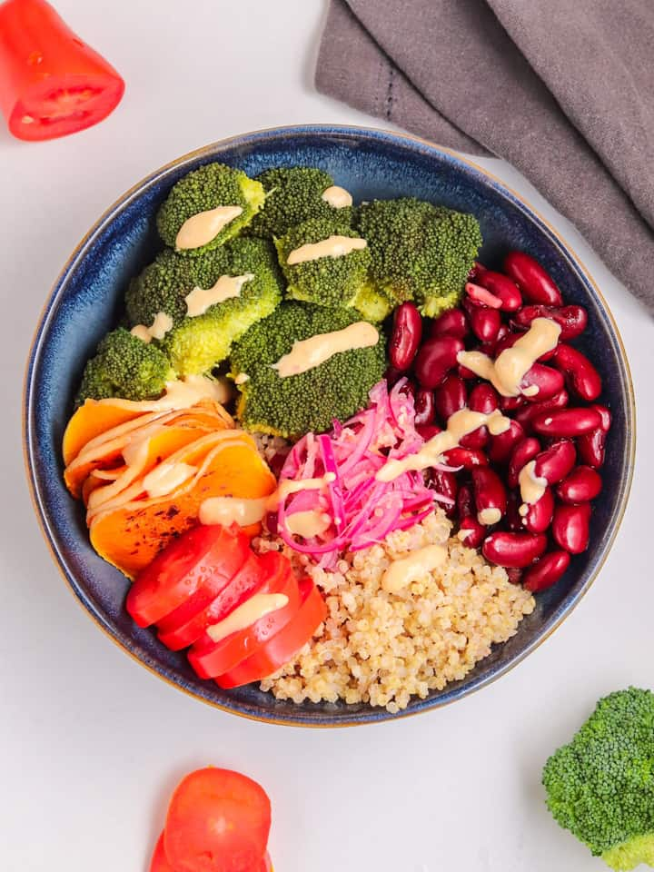 Vegan buddha quinoa bowl with yogurt dressing