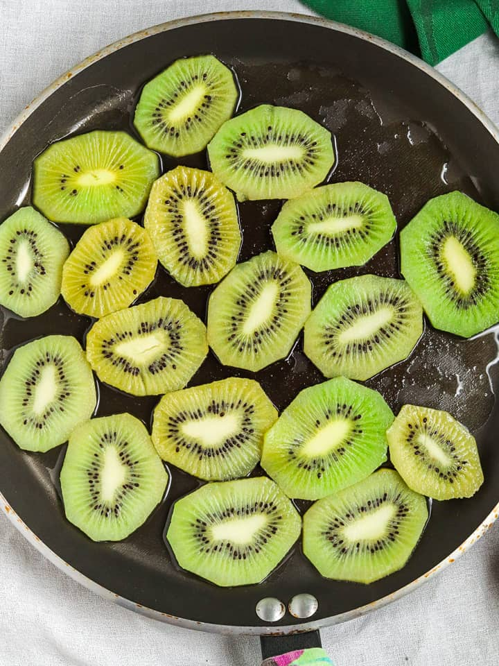 cooking kiwifruit in a pan