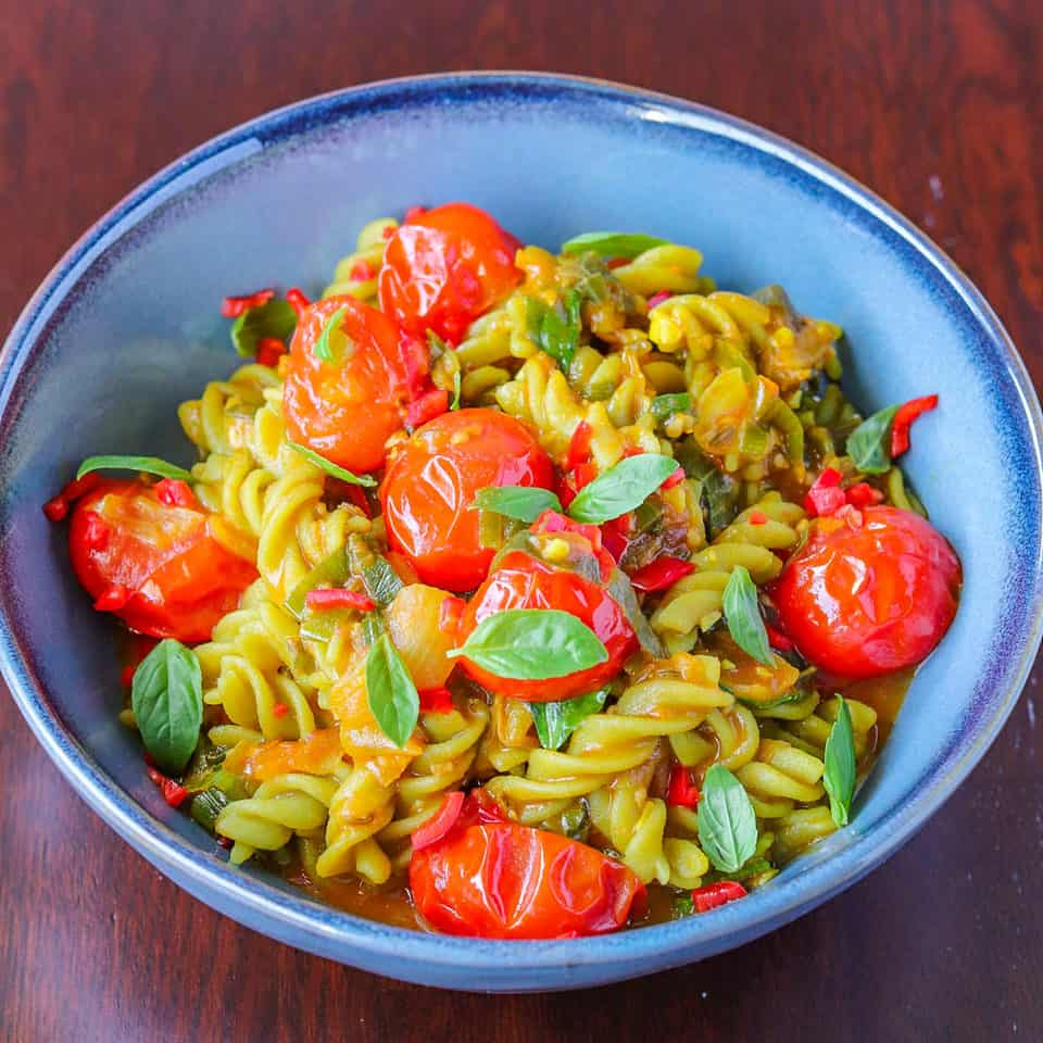 cherry tomatoes with gluten-free pasta bowl