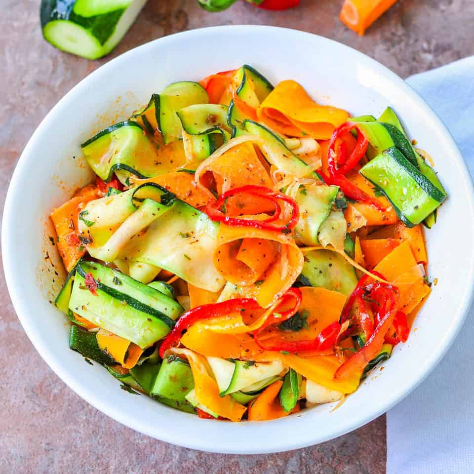 spicy carrot & zucchini pasta served in a bowl