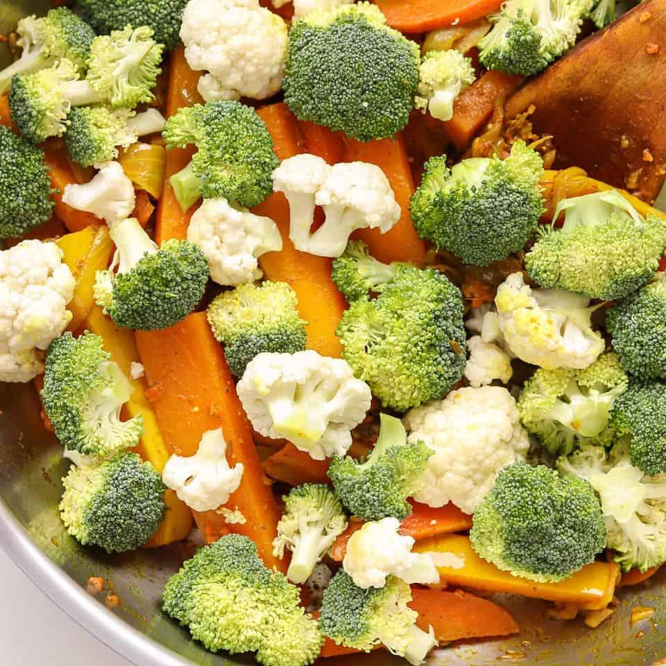 Add broccoli & cauliflower into veggie stir fry recipe