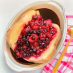 baked potato served with red fruits for breakfast