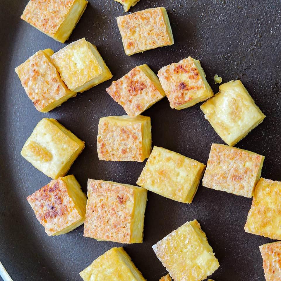 cooking crispy tofu on a pan