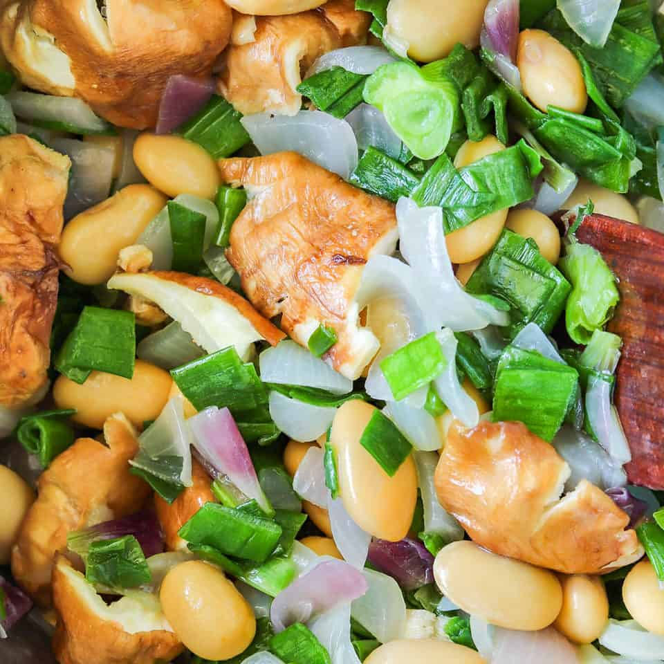 cooking tofu soup with shiitake mushrooms