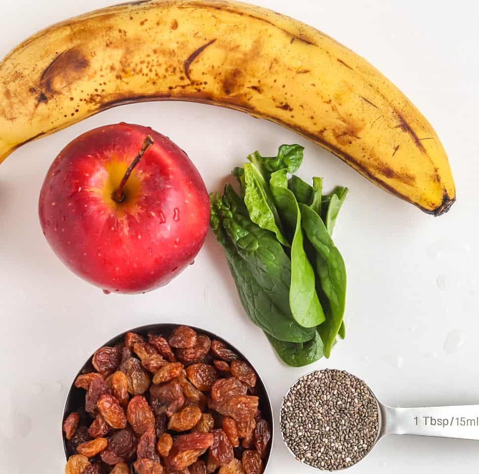 Banana, chia, apple, spinach and raisins for green smoothie