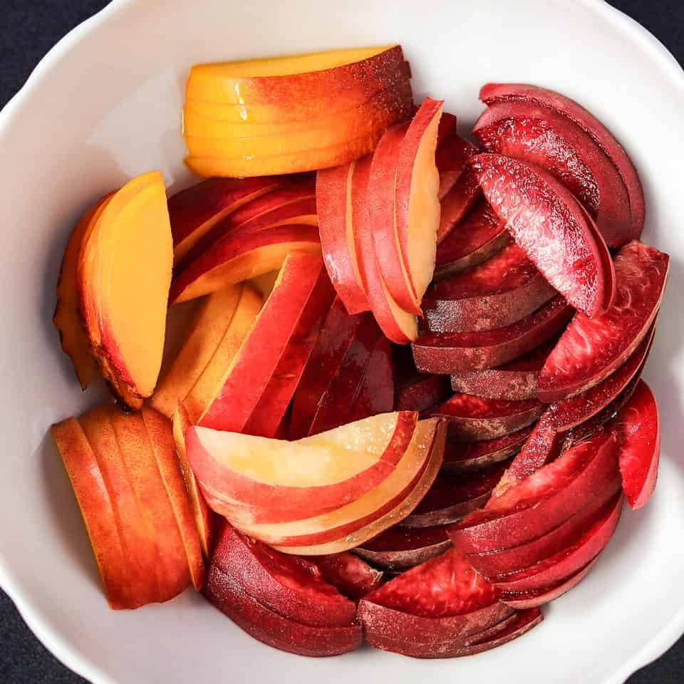 sliced nectarines & peaches in a bowl