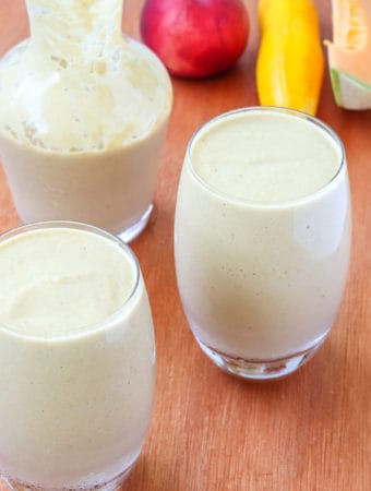 fresh peach smoothie with summer fruits