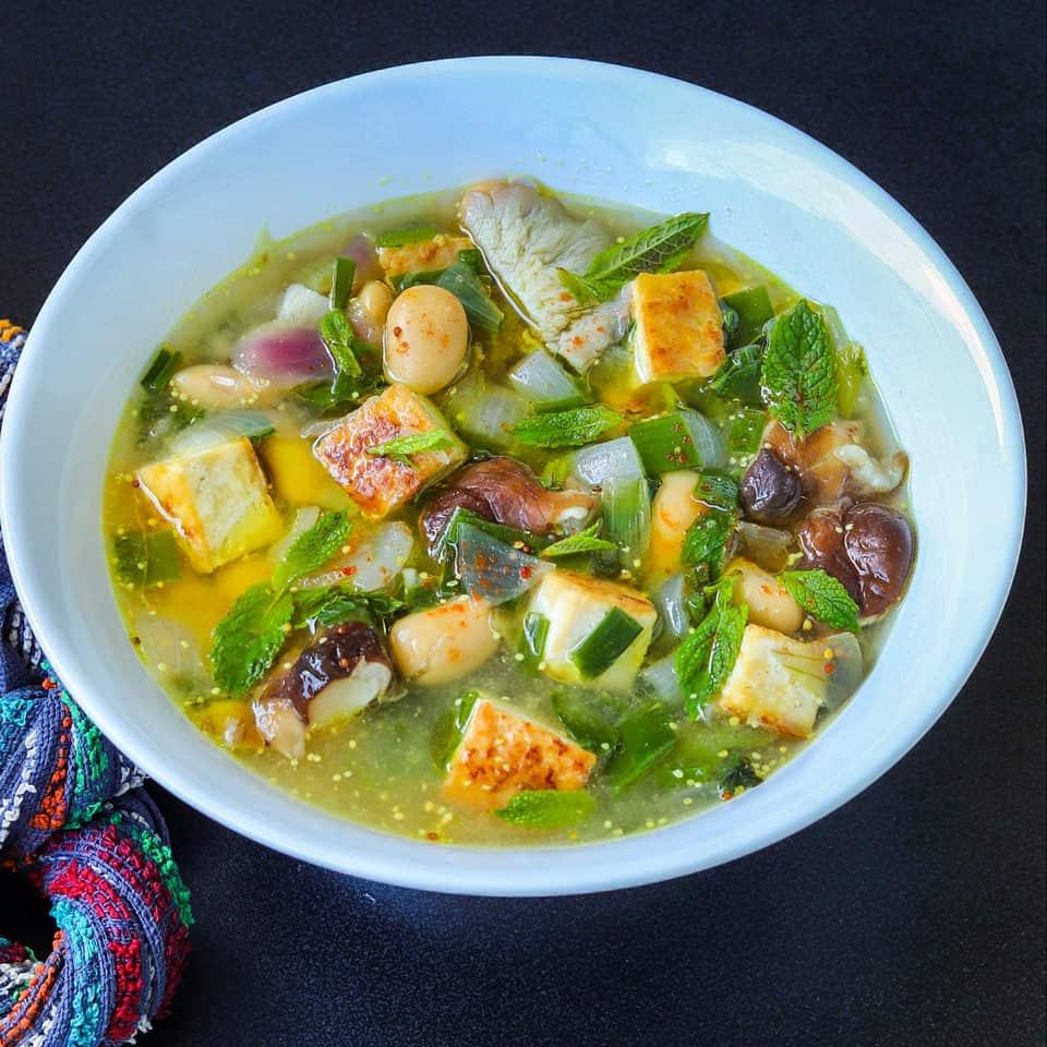 tofu soup with shiitake mushrooms in a bowl
