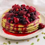 Split pea oatmeal pancakes served with cooked red fruits