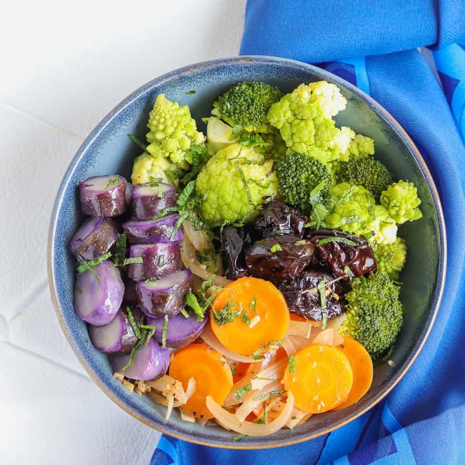 purple potato, broccoli, carrots, and prunes bwl
