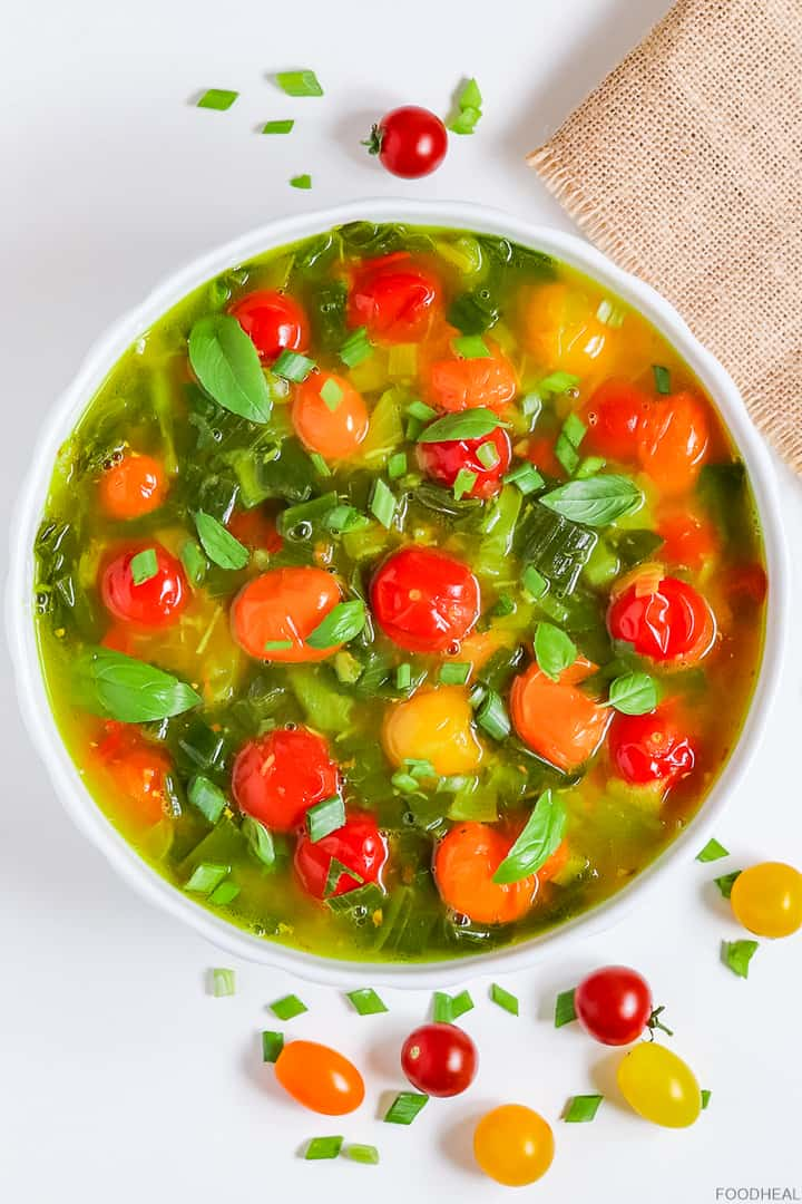 Spring onion soup with cherry tomatoes