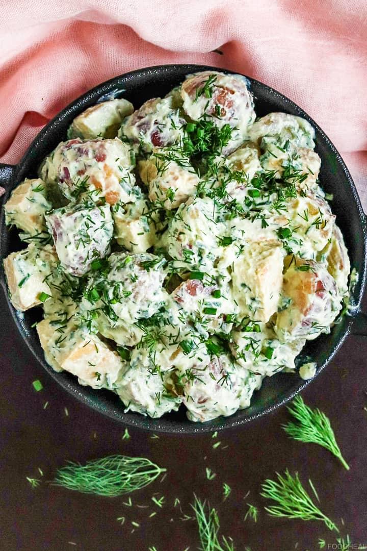 vegan potato salad in a black bowl