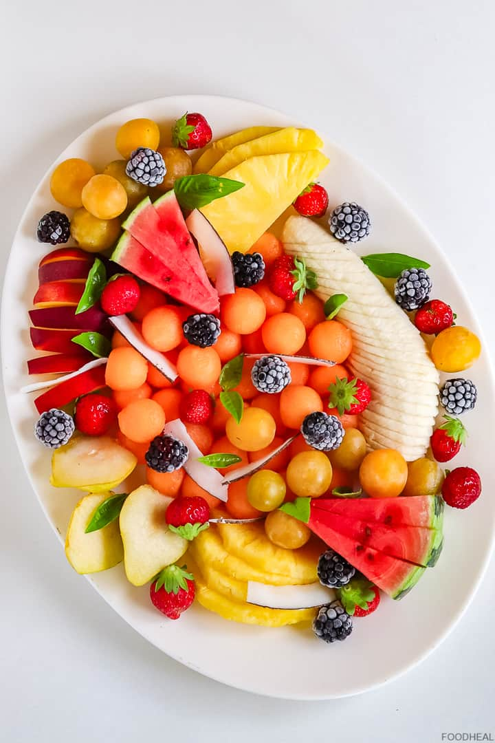 fruits cut in different shapes creating a fruit salad