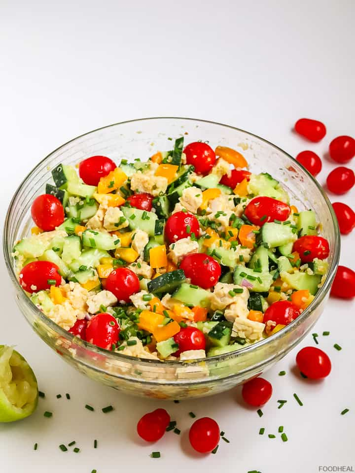 a bowl of cucumber salad with quinoa & cherry tomatoes