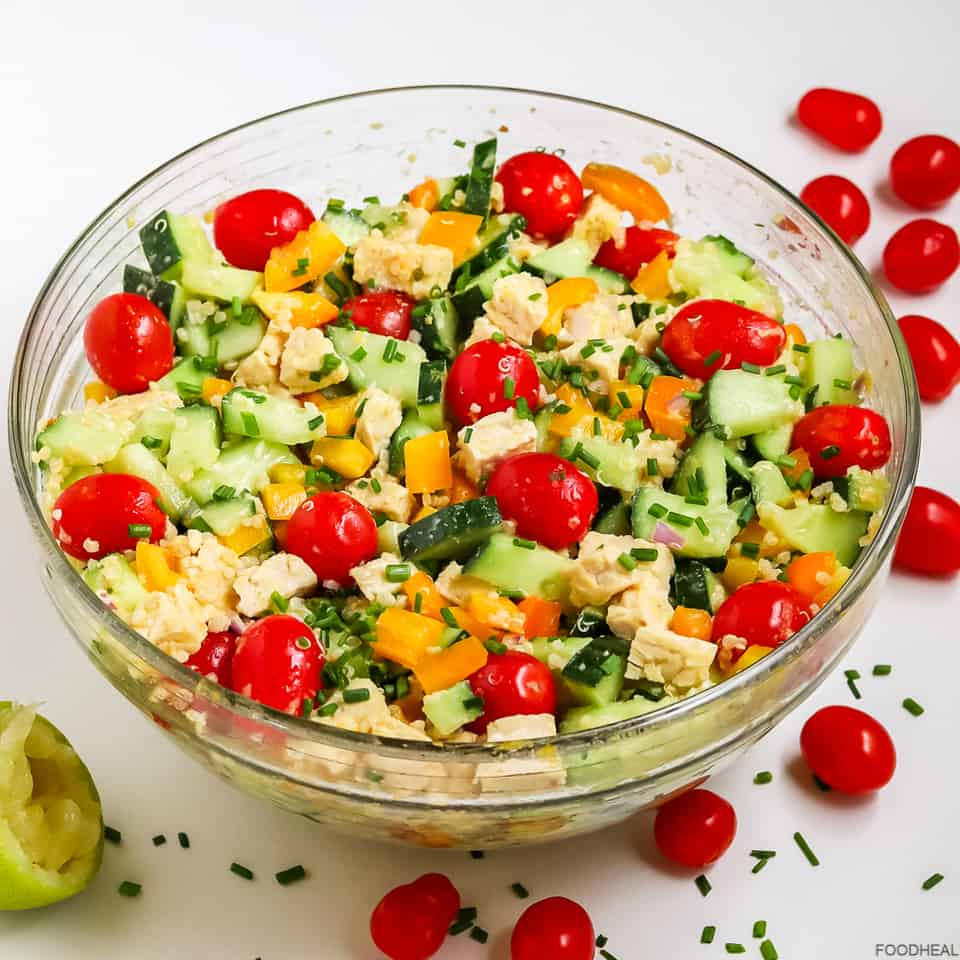 a bowl of cucumber quinoa salad with cherry tomatoes