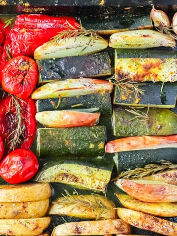 Juicy roasted spiced vegetables in a baking sheet