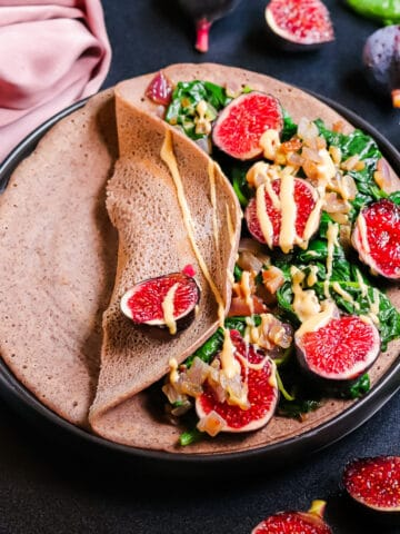 Sauteed spinach with onions, figs served on a pancake