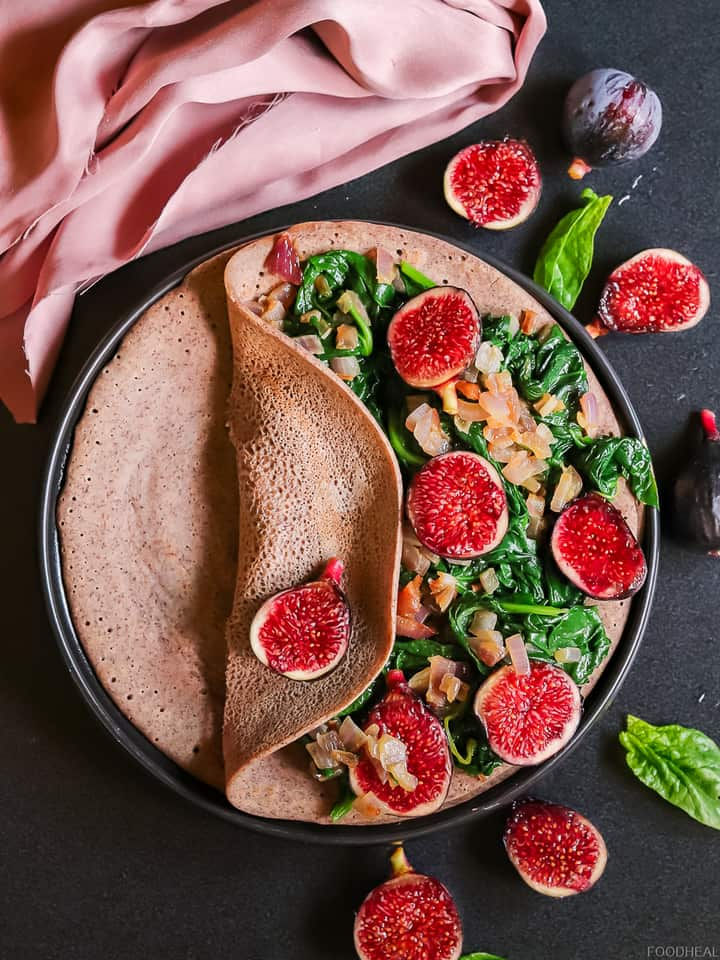 Onion, spinach, figs on a pancake