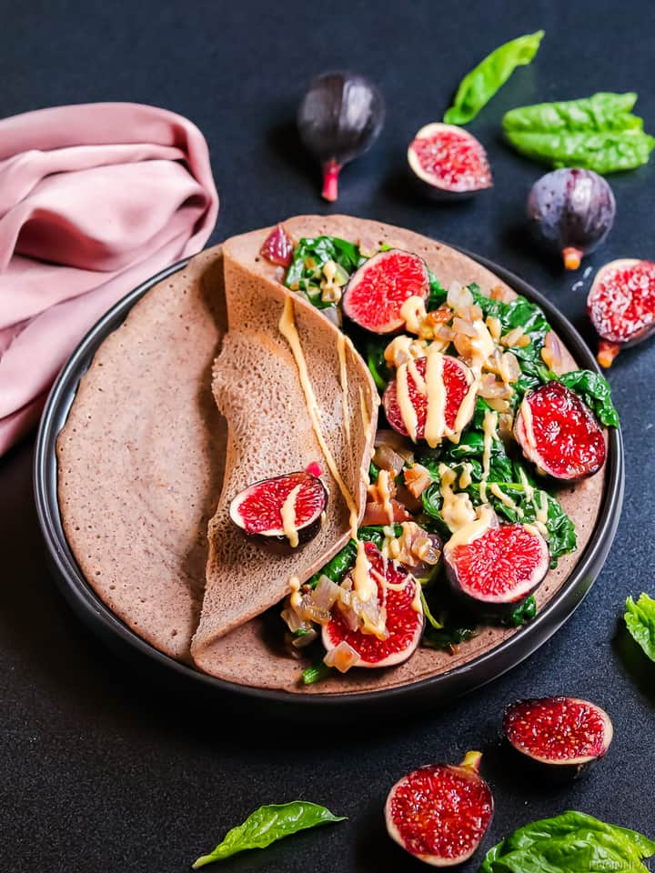 sauteed spinach in onions, with figs served on a pancake