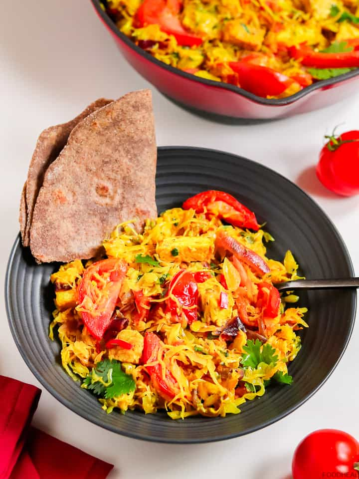 Served cabbage stir fry with tomatoes & chapati