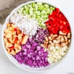 chopped ingredients of 3 cauliflower salad in a bowl