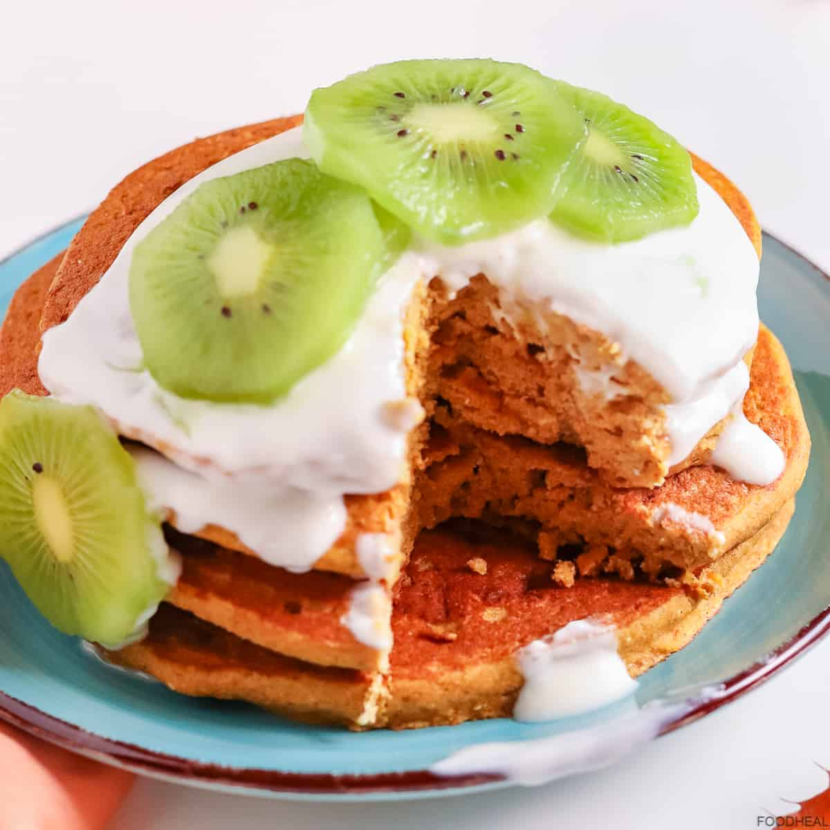 Buckwheat pumpkin pancakes with yogurt & kiwi