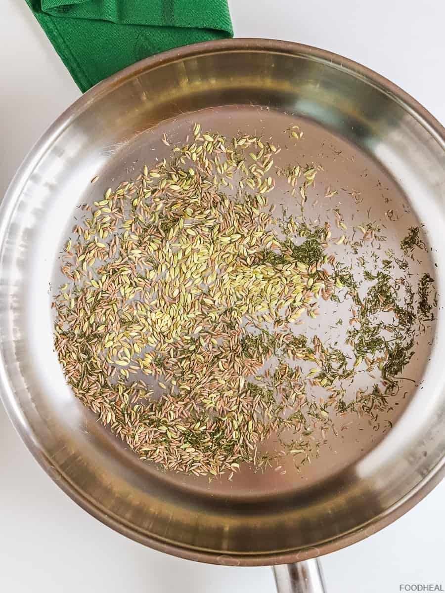 cumin & fennel seeds with dry dill in a hot pan